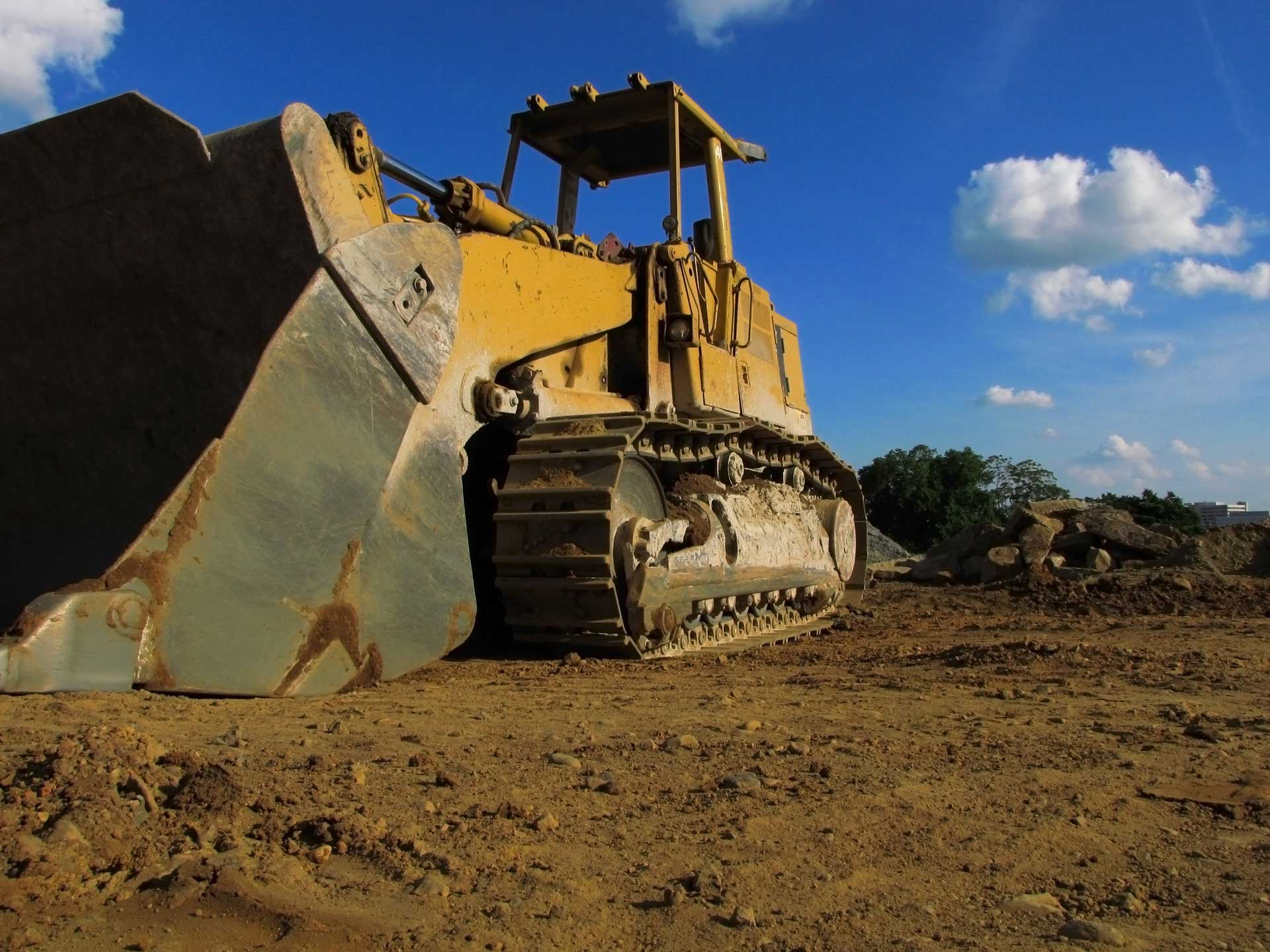 Image of bull dozer sitting idle on a work-site